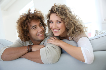 Sweet couple relaxing at home in sofa